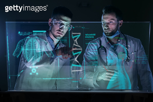 A couple of doctors analyze the patient's medical situation by checking on a glass monitor with a futuristic holography