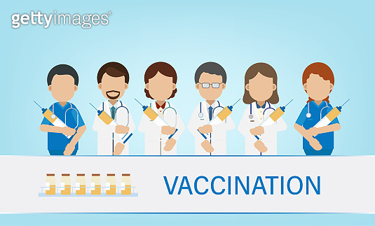 Vaccination concept with doctors hold syringes