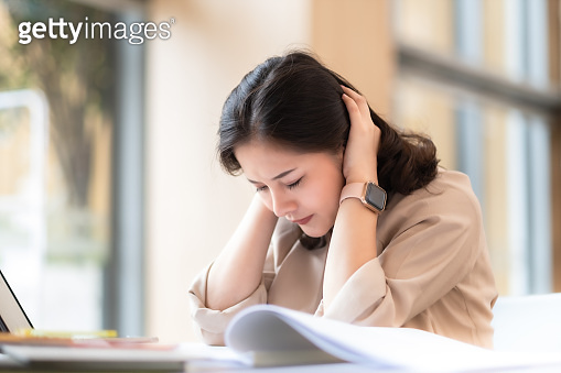 Architect or interior designer working with material sample board in showroom. Business of Real estate, home decoration .Stressed business woman working on a laptop.