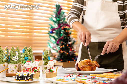 Thanksgiving or christmas Celebration Asian  Family Dinner Concept.family having holiday dinner.Happy family cooking for party.