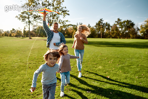 There are no words to describe how special kids are. Happy family playing a kite. Outdoor family weekend