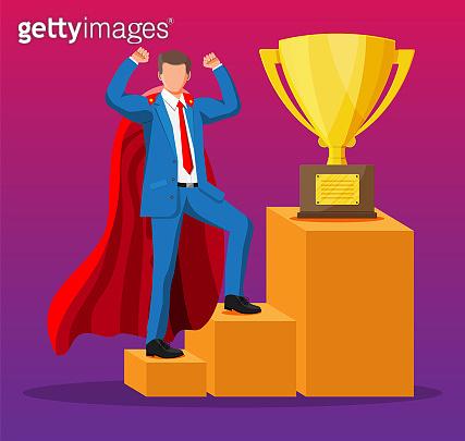 Super businessman in cape goes to golden trophy
