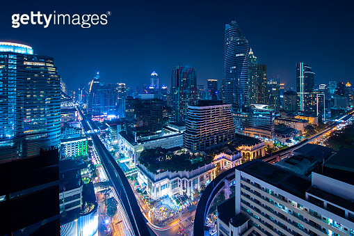 Bangkok skyline downtown district at night in blue hour.