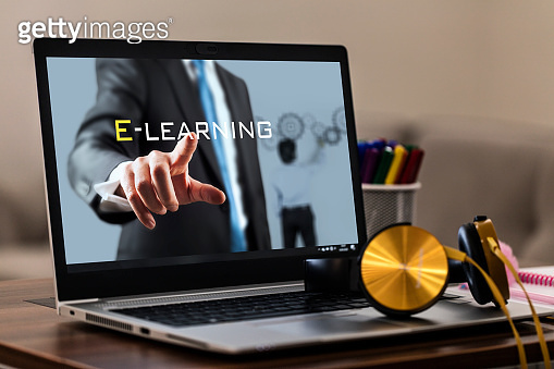 Online Education E-Learning Concept with Laptop and Headphones