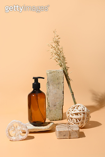 SPA accessories, soap, cosmetic care, oil on beige.Monochrome creative composition. Natural skin care concept. Wellness.