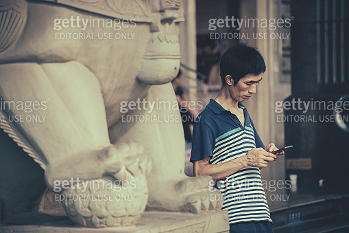 Man with a smartphone in the Chongqing city
