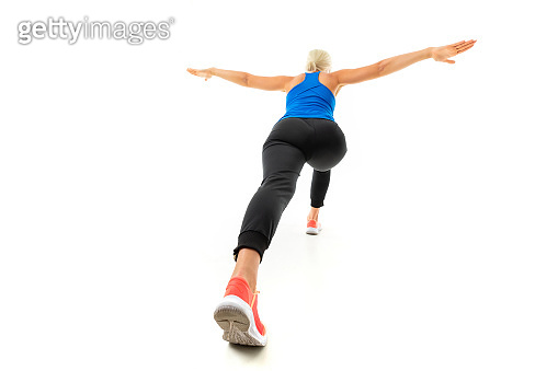 Sport caucasian woman do exercise and jump isolated on white background