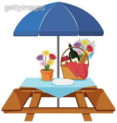 Picnic table with food and drink on the table