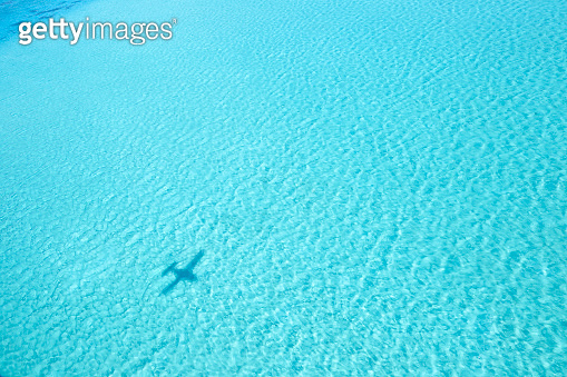 Shadow Of Small Airplane On Shallow Tropical Waters