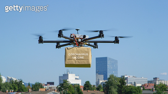 CLOSE UP: Small unmanned copter transports coronavirus vaccine to a nearby city.