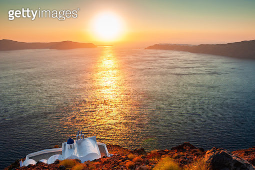 Small church on the cliffs, Santorini island, Greece.