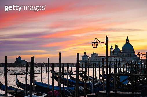 Gondolas on Grand canal at sunset in Venice, Italy.