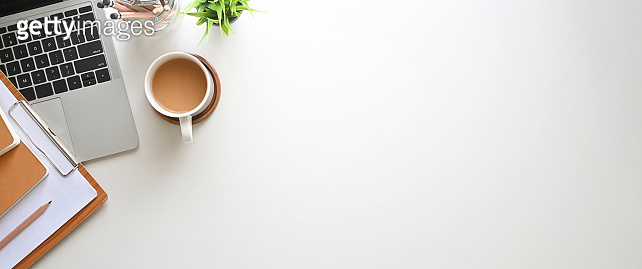 Simple Top view table - Creative flat lay office desk. Laptop, notebooks and coffee cup on white background. Panorama banner background with copy space.