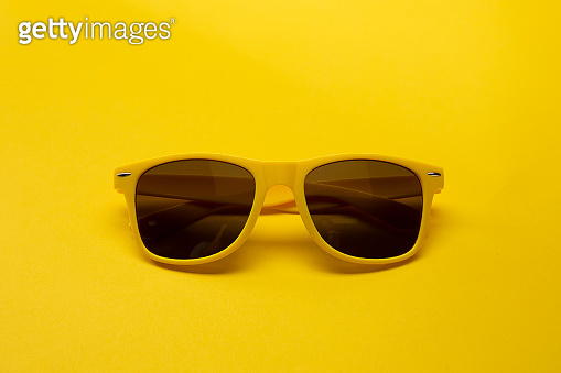 Bright Sunglasses on a Yellow Background