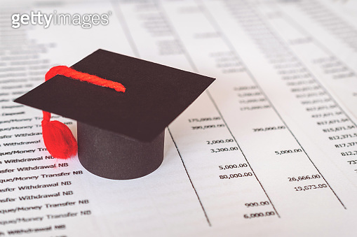 Graduation hat on statement. Statement for education Finance Loan