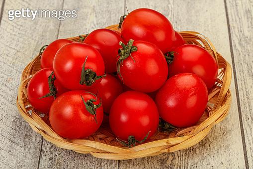 Ripe juicy cherry tomato in the bowl