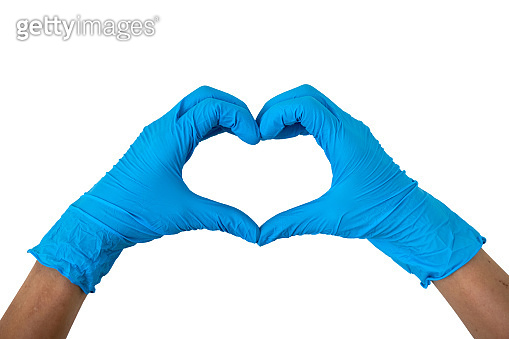Human wearing blue gloves rising hands making finger heart shape, disposable rubber latex gloves for professional medical safety and hygiene protection from Coronavirus disease COVID-19