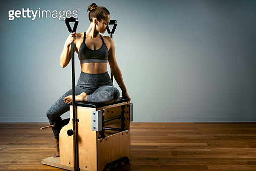 combo wunda pilates chair woman instructor fitness yoga gym exercise. Copy space. sports banner