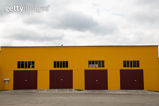 Front of the hangar for trucks. Four entrances.