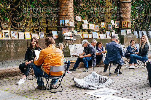 Street artists near the Griboedov canal Embankment in Saint Petersburg.