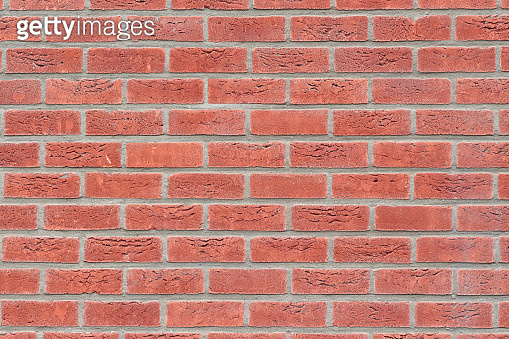 front view on red brick wall