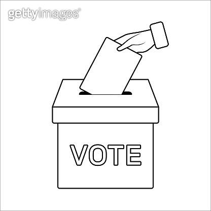 Hand puts the ballot in the ballot box.