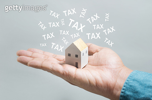 Property tax,interest rate,finance loan increase.investment planning.business real estate.profit of banking.