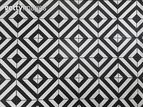 shabby black and white rhombus tiles on a coffee shop floor