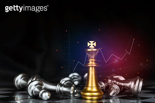 golden king surrounded with silver chess pieces on chess board game competition with graphic graph chart on dark background, chess battle, victory, success, team leader, business strategy concept