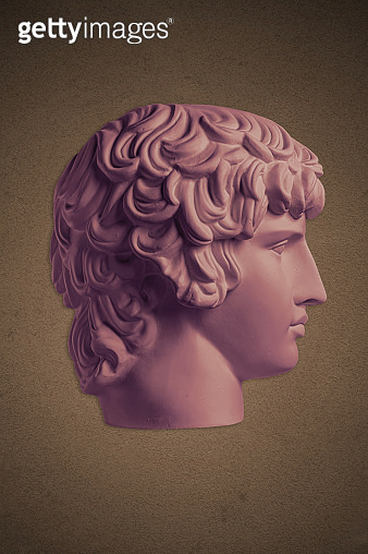Poster with gypsum copy of ancient famous statue Antinous head on dark textured background. Plaster antique sculpture young man face Renaissance epoch.