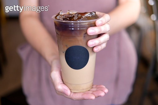 barista made the fresh ice coffee latte. cold refreshment with the template sticker logo.