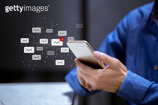 Business using smartphone,with email icon,email inbox electronic communication graphics concept.