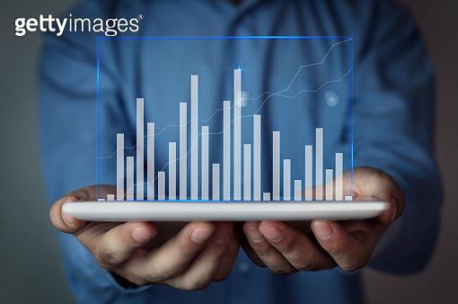 Businessman holding graph. Finance concept.