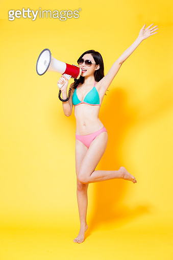 asian bikini girl use loudspeaker