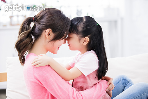 Mom hold daughter in her arm