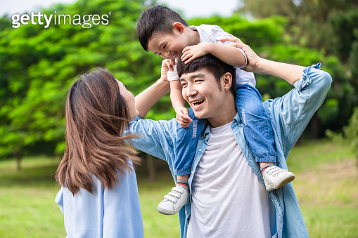 Young parents play with kid