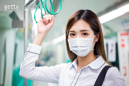 woman with mask in mrt