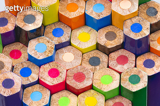 Colored wooden pencil tip, arranged in various colors, is beautiful background detail art blur