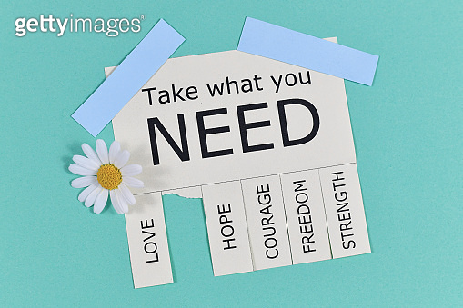 Tear-off stub note with text 'Take what you need' and words 'Love, Freedom, Hope, Courage' and 'Strength' with flowers on light teal blue background