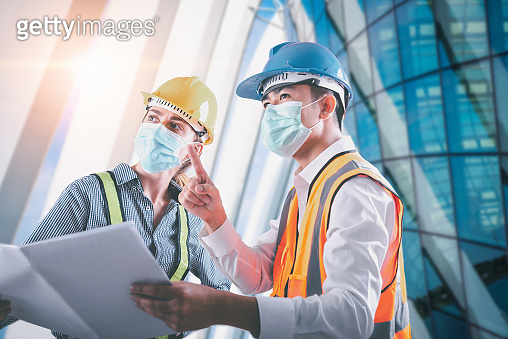 Construction Engineer/ Architect Builder Teamwork Inspection Civil Work at Construction Site, Engineering Inspector Team in Safety Equipment Discussing about Constructing Plan for Steel Architecture.