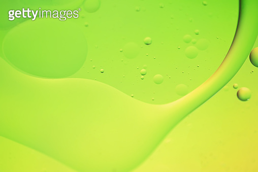 Green and yellow abstract background picture made with oil, water and soap