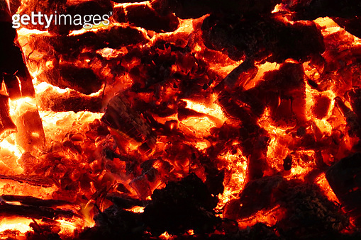 Image of roaring, dancing flames from big bonfire, burning wood and cow dung cakes against night sky, Indian festival