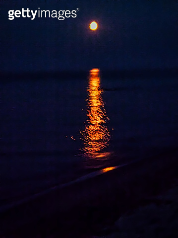 Reflection of the Moon over the Sea Near the Beach.