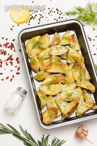 Baked potatoes in baking dish.