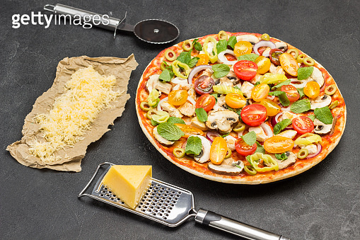 Pizza with ingredients is ready to bake.