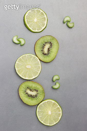 Kiwi, lime and celery slices. Green abstract still life.