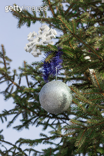 Christmas decorations on branches of Christmas tree
