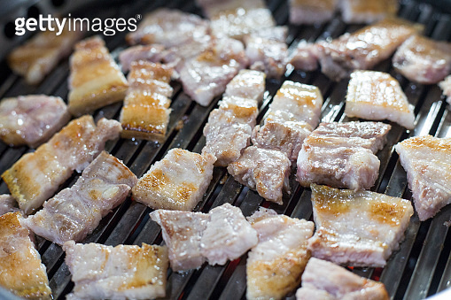 Grilled pork belly, one of the most popular foods in South Korea. This food is called Samgyupsal Gui