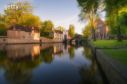 Bruges canals at sunrise. Brugge, Belgium