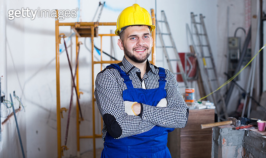 Portrait of builder which is doing repair